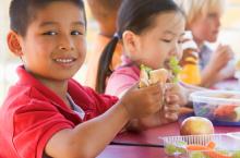smiling child eating